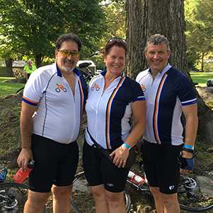 Employees participating in bicycling event