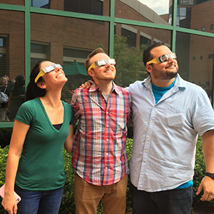 Employees viewing solar eclipse